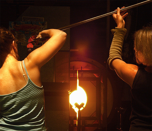 Women working with molten glass