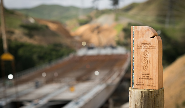 The teams' Workplace NZ Health and Safety award onsite at the bridge over Cannons Creek.
