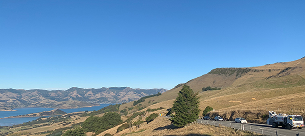 Rural road with view of Akaroa in the background