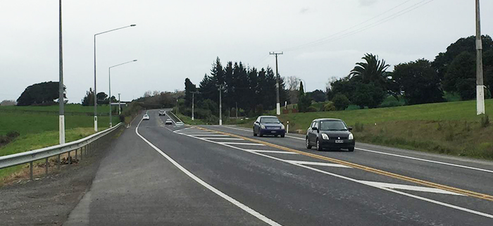 Rural road along SH22 near Drury with two cars on the right.