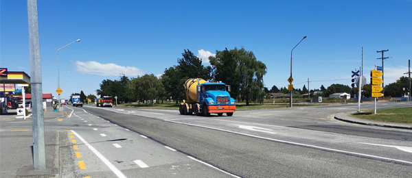 Concrete truck passing State Highway 1 intersection and Lagmhor Road.