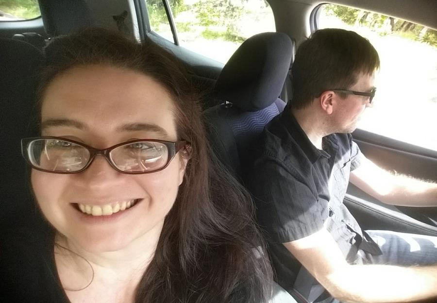 Carrie carpooling with her husband Andy
