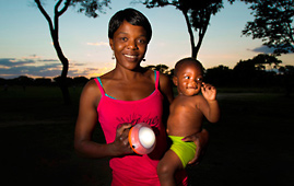 A woman holding a solar lamp