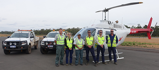 The first combined patrol of Fisheries and Water Corporation officers get ready to take to the air in the helicopter